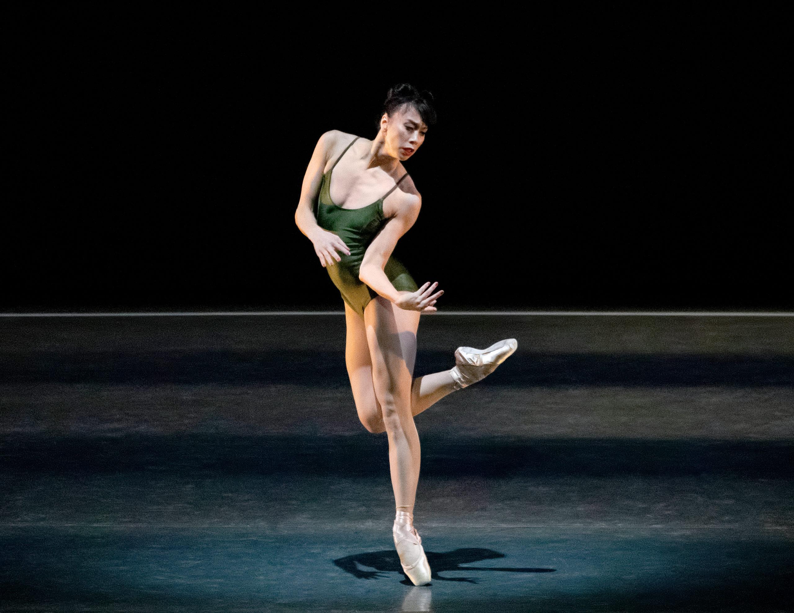 Georgina Pazcoguin, wearing a green leotard,